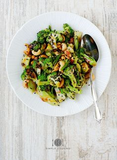 SWEET AND SOUR BROCCOLI SALAD ½ cup of sweet and sour sauce  3 small stalks of broccoli, cleaned, cut into small florets and blanched 1 TB of sesame oil, black sesame seeds, a handful of roasted cashews, and 2 stalks of sliced green scallions.