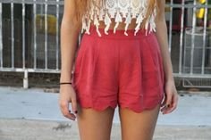 Crochet blouse with red shorts