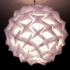 Make the designer pendant lamp you've always dreamed of with inexpensive plain white paper and a paper lantern. It will take you a while to create all the origami pieces but it is much easier than it looks and the result is certainly rewarding. And your handmade lantern will be a snip of the cost of a designer piece. Full instructions after the jump. | Difficulty: Intermediate; Length: Long; Tags: Paper Crafts, Decorations, Homewares, Origami