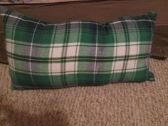 DIY Pajama pant leg pillow: I made this little cozy pillow for my husband's backpacking trip last week. He loves that it is so light weight and rolls up so it was easy to store in his backpack. And it was cheap since I just cut off a leg of some short pajama pants, stuffed it with poly-fil and sewed it up by hand.
