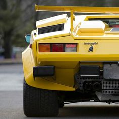 from @classiccarchasers -  Italian Origami:  _____________________________________________  1988 Lamborghini 5000 Quattrovalvole  The only 1988 U.S. example in Giallo Fly with white leather interior  @ ErikFullerPhoto  As the successor to what is considered the worlds first supercar - the Lamborghini Miura - the encore begged to be nothing short of sensational. Its origami shape was attributed to Marcello Gandini of Bertone Design and its various scoops scallops and spoilers only added to…