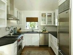#SmallKitchenDesign not a fan of white cupboards but how it works with the silver appliances