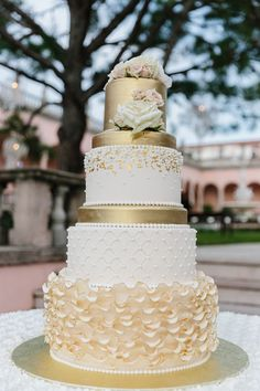 Glam gold textured wedding cake: Venue: Ringling Museum of Art - http://www.stylemepretty.com/portfolio/ringling-museum-of-art Floral Design: Victoria Blooms - http://www.stylemepretty.com/portfolio/victoria-blooms-florals Groom's Attire: Hugo Boss - http://www.hugoboss.com/us/ Read More on SMP: http://www.stylemepretty.com/2017/03/21/blushing-florida-wedding-day/