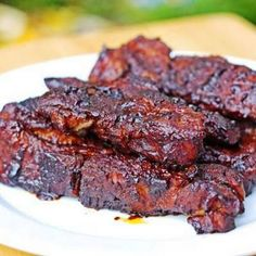Saucy Country-Style Oven Ribs - This recipe uses boneless country-style ribs and boils then bakes them. I added a thick layer of minced garlic on one side of the ribs on top of the bbq sauce. These ribs were delicious! Ribs In Oven, Ribs On Grill, Bbq Ribs, Boneless Country Style Ribs, Smoked Country Style Ribs, Country Ribs Oven, Best Ribs Recipe, Recipe 4, Recipe For Country Style Beef Ribs
