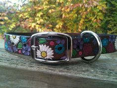 www.facebook.com/GratifyDesigns  Charming Leather Dog Collar $49 - This Charming Leather Dog Collar has many beautiful features that make it unique. Located at the center of the collar is the name of your pet which has a metallic flare. This allows for the name to stand out.  The the length will be made to fit your pet just right. Upon ordering please leave me your dogs 'approximate' neck measurement in inches. If you prefer my designs can be customized to your liking