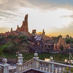 """sunset over big thunder mountain from the porch of phantom manor. Disney Parks, Walt Disney, After Dark, Disney Stuff, Thunder, Paris Skyline, Porch, Mountain, Sunset"
