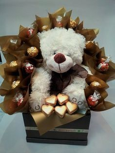 Chocolate bouquet with a large fluffy teddy and decorated with Lindt, Ferrero and gold hearts