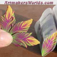 Purple green and yellow feather cane