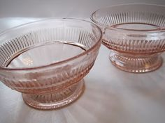 These are Coronation pattern Depression Glass pieces, and one source says the name is because a coronation was going on in England when this line was first launched in 1936.