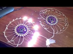 Connecting two Arduino Lilypad boards to make a swirling pattern of Lights! - YouTube