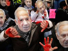 Anti-Israel demonstrators led by the protest group Code Pink wear masks of Israeli Prime Benjamin Netanyahu as they sit at the entrance to the American Israel Public Affairs Committee (AIPAC) policy conference at the Washington Convention Center in Washington. Netanyahu has come under almost unprecedented criticism from the U.S. administration and in Israel for his planned speech to Congres, as international talks with Iran are under way to secure a deal on Teheran's nuclear program