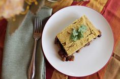 Meatless Tamale Pie ◦1 large onion, diced ◦1 large red or green bell pepper, diced  ◦4 large cloves garlic, minced ◦2 tsp. ground cumin ◦2 tsp. Ancho chili powder ◦2 tsp. dried oregano ◦1 tsp. smoked paprika ◦1-15.5 ounce can black beans, rinsed and drained ◦1-15.5 ounce can pinto beans, rinsed and drained ◦1-14.5 ounce can diced fire-roasted tomatoes, including juice... More recipes on plantbasedcooking.com