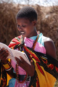 Masai woman reading cookbook | Flickr - Photo Sharing!  Location: Kenya