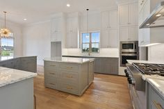 White Carrara marble counter tops combined with the Timber Wolf cabinets make for a calming and welcoming room.