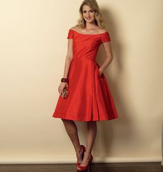 Off-the-shoulder Butterick dress sewing pattern featuring pleat details and flared skirt. B6129.