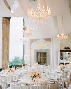 "The Tuscan Wedding on Instagram: ""There's nothing like the magic of a wedding reception with Tuscan landscape as a  backdrop. Amanda & Josh's vision comes true: blush toned…"" Tuscan Wedding, Wedding Reception, Amanda, Backdrops, Ceiling Lights, Table Decorations, Landscape, Chandeliers, Blush"