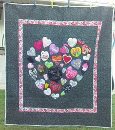 All the hearts are cut out of baby clothes then shaped into a heart.  Miss Brinley will continue to use these clothes she has out grown  Really enjoyed making this quilt