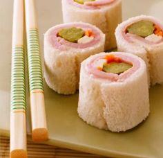 Para uma festinha com o tema Japão: sanduíche de sushi. Pão de forma enroladinho com presunto, queijo, tomate e pepino.