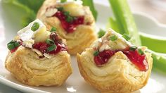 Top bite-size puff pastry with creamy Brie, sweet cherry preserves and crunchy pecans for an easy, elegant appetizer.