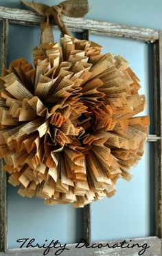She uses an old book to make this wreath.  I like how she displays it in window frame.