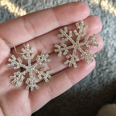 Snowflake earrings I know it's not winter - but these are perfect for a teacher!! These snowflake earrings have been worn once. From Francesca's. On one earring there is some black on the back - not sure what it's from by doesn't look tarnished. Reasonable offers appreciated. Bundle and save! Francesca's Collections Jewelry Earrings