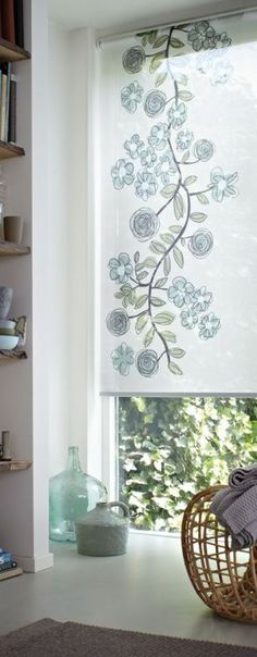 This trailing vine design adds great design detail to this narrow window. Luxaflex Roller Blind.