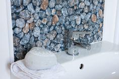 Pebble design splashback created with d-c-fix® sticky back plastic. Wipe clean and durable. http://www.amazon.co.uk/d-c-fix%C2%AE-Plastic-adhesive-TrendyLine-343-1011/dp/B00CYAZZVI/ref=sr_1_1?s=kitchen&ie=UTF8&qid=1438080060&sr=1-1&keywords=pebbles+d-c-fix