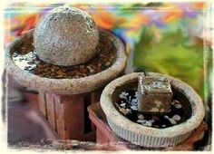"""Kandy Jones  says, """"These are hypertufa fountains I made using a beach ball and half of a fan cage on the big one and a deli tray top and candy container on the smaller one) Birds love 'em!"""""""