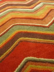 @Overstock - Primary materials: Wool Pile height: 0.4 inches Style: Contemporary http://www.overstock.com/Home-Garden/Hand-tufted-Red-Brown-Geometric-Wool-Rug-8-x-11/6271790/product.html?CID=214117 $534.99