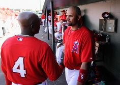 TEMPE, AZ - MARCH 12: Albert Pujols #5 of the Los Angeles Angels of Anaheim speaks with first base coach Alfredo Griffin in the third inning against of the Los Angeles Dodgers during a spring training baseball game at Tempe Diablo Stadium on March 12, 2012 in Tempe, Arizona. (Photo by Kevork Djansezian/Getty Images)
