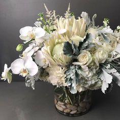 flowersandfanciesPure & Sophisticated. #whiteflowers #romantic #angelic #bmorefancy #flowers #orchids #kingprotea #flowerarrangement #flowermagic #samedaydelivery #open7daysaweek
