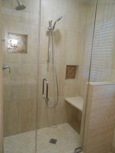 #Bathroom #Remodel - 12x24 porcelain tile on the shower walls with 2 recessed shampoo shelves.  2x2 porcelain tile on the shower floor.  Glass tile mosaic on shampoo shelf backs.
