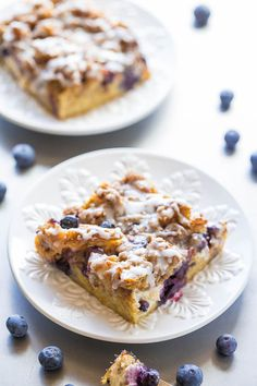Overnight Blueberry Waffle Breakfast Bars - Blueberry waffles layered with cream cheese, blueberries, streusel, a glaze, and more