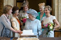 Job done: Anne, the Princess Royal smiles at the Queen after completing the cake cutting while Sophie, Countess of Wessex looks on.