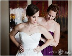 A gorgeous bride gets help with her wedding gown at her suite at the Sheraton Resort in Steamboat Springs, Colorado. - April O'Hare Photography http://www.apriloharephotography.com