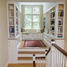 Create a mini library/reading nook with window seat bench off stairway landing.  Love how there are open shelves at the end of the bookcase shelving and additional drawers & cabinets underneath.  Newton Centre Library from The Best Projects From This Old House TV by Kevin O'Connor.