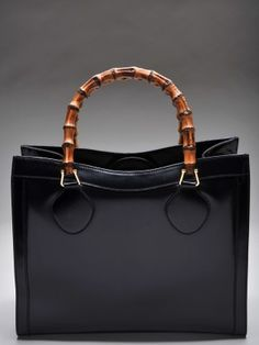 Gucci Vintage c.1980 ~ I have this one. It's huge but fabulous. Very structured.