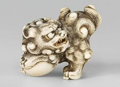 A large Kyoto school ivory netsuke of a roaring shishi. Early 19th century