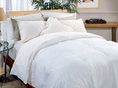 Naples 700-Thread Count Down Alternative Comforter, Twin by Blue Ridge Home Fashions, Inc.. $61.37. 700-Thread-count fabric. The size of the twin comforter is 68 by 88-Inch. 40-Ounce fill weight; filled with garneted polyester. Machine washable in commercial washer. Comforter shell is made of 100-Percent cotton. 100% Cotton. Naples 700 Thread Count Down Alternative Comforter. 700-thread count, 100-Percent cotton cover. End to end box construction with self piping. Filled with ...