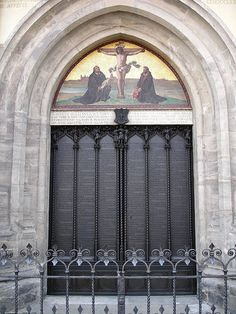 At the Castle Church in Wittenberg, Germany, where Martin Luther nailed his 95 thesis. They are now inscribed on the doors.