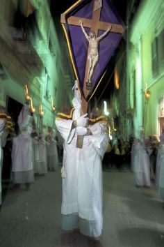 Chieti, Holy Friday The face covered, a man attend to the procession of Holy Friday in Chieti, Abruzzo,