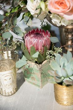A marsala protea brimmed from a wooden box. #RusticDecor Photography: EDLT Photo. Read More: http://www.insideweddings.com/weddings/an-oceanfront-vintage-inspired-wedding-in-laguna-beach-california/699/