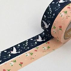 Washi tape set of colourful printed tapes - one navy floral background with a swallow design, and the other a delicate blush pink background with a design of roses and tulips winding through it.