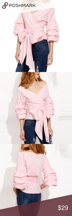 Pink Ruffle Sleeve Wrap Top Brand new; never worn! Very stylish and exaggerated. Perfect statement piece. Size XS. Can fit a small. Tagged Zara for exposure only! Zara Tops Blouses