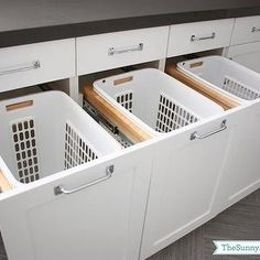 shaker cabinets, white shaker cabinets, laundry room cabinets  pull out hamper,