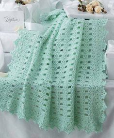These seven lacy and lovely crochet afghans designed by Kay Meadors work up quickly in sport weight yarn for a special baby! The centers of these afghans finish in a flash, leaving you time to add the elegant crocheted edgings that give the wonderful wrap Filet Crochet, Baby Afghan Crochet, Crochet Borders, Baby Afghans, Afghan Crochet Patterns, Crochet Stitches, Crochet Edgings, Baby Blankets, Crochet Phone Cases
