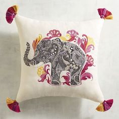 Exotic with modern appeal, our Embroidered Elephant Pillow dresses up your favorite chair or sofa with colorful style. It has tassels, textures and UV-resistant fabric (OUTDOOR pillow)