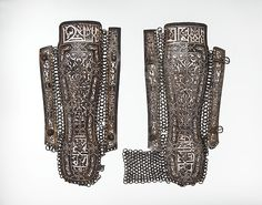 Pair of Leg Guards Date: late 15th century Culture: Iranian Medium: Steel, damascened with silver and partly gilt Dimensions: Length of right leg guard, 16 in. (40.64 cm) Width of right leg guard, 4 1/4 in. (10.8 cm) Length of left leg guard, 15 3/4 in. (40.01 cm)