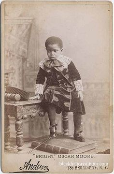 +~+~ Antique Photograph ~+~+    Ornately dressed young boy looking a little tentative.