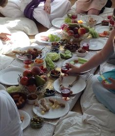 The Roman feast. Fresh & dried fruits, salad and olives. Breads, meats, cheeses and biscuits were arranged on side tables. The children were seated on pillows arranged around a low platform covered in a table cloth (I used a wallpaper paste table with no legs!)